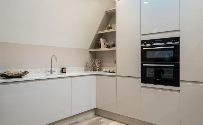 Sloping Ceiling In Apartment Kitchen White Gloss