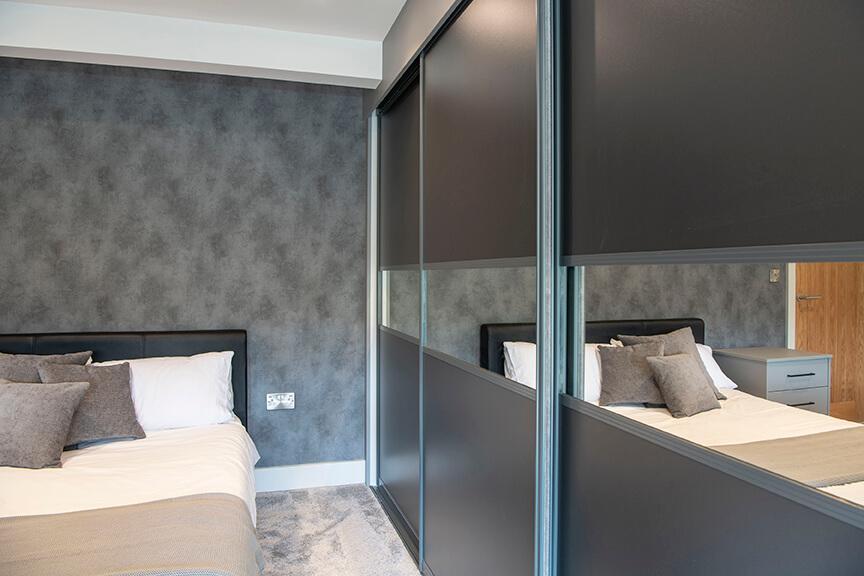 Modern Sliding Bedroom Wardrobes With Bedside Tables 3