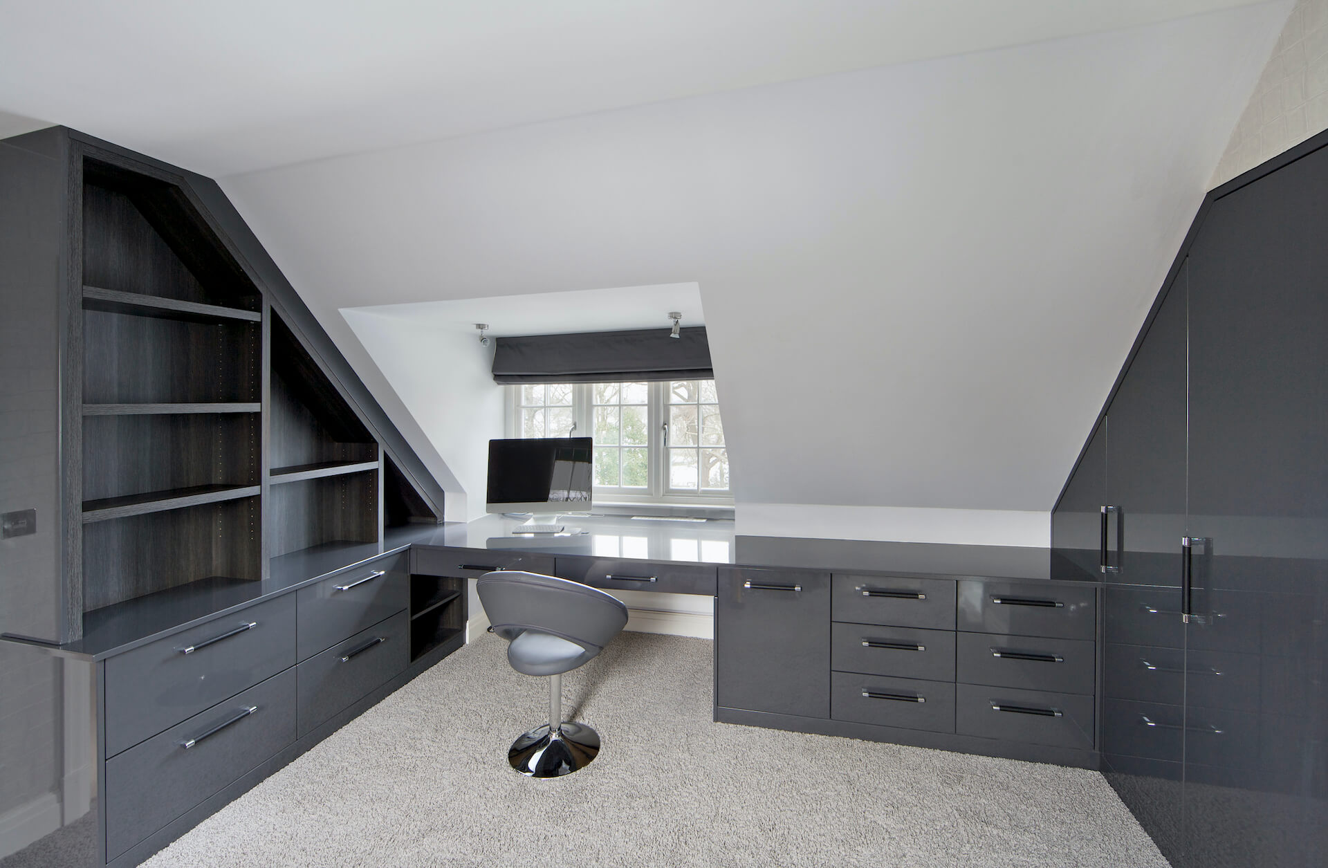 Home Office With Nicely Fitted Dark Grey Shelving, Drawers And Cupboards